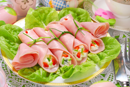 garnished: ham rolls stuffed with cheese and vegetables for easter breakfast