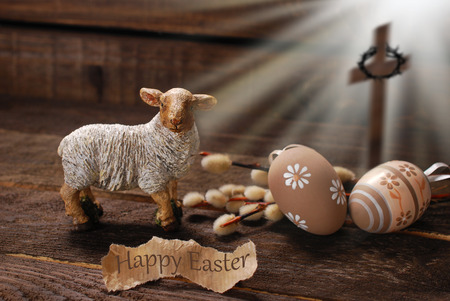 easter concept with cross in light rays and lamb as a symbol of  sacrifice offered to God Stock Photo