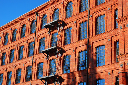 brick building: old brick factory building in Manufactura rebuilt as a hotel in Lodz,Poland