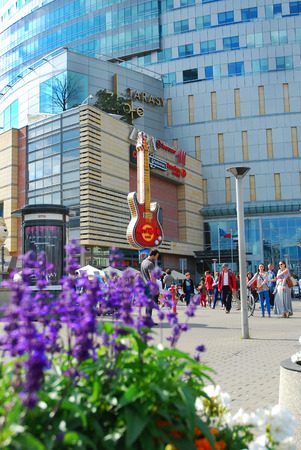 hard rock cafe: WARSAW,POLAND-JULY 15,2015:famous guitar-symbol of Hard Rock Cafe in the center of Warsaw and shopping mall Golden Terraces Editorial