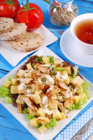 epicure: plate of ceasar salad with grilled chicken, cheese,croutons ,lettuce and garlic sauce Stock Photo