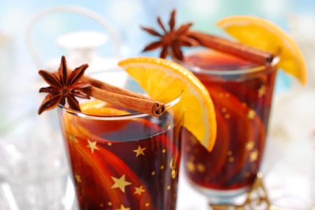 christmas tea: two glasses of mulled wine with oranges and spices for christmas