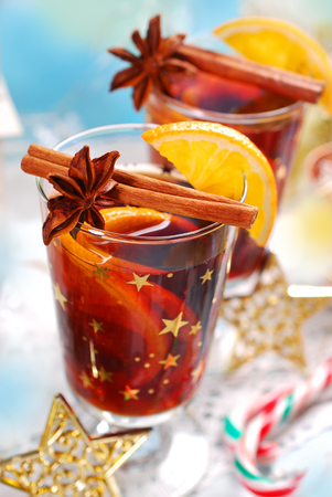 wine glasses: two glasses of mulled wine with oranges and spices for christmas