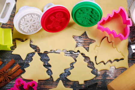 plastic christmas tree: ingredients and utensils for baking christmas cookies on rustic wooden table Stock Photo