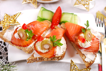 salmons: smoked salmon and cream cheese canapes as appetizer for christmas