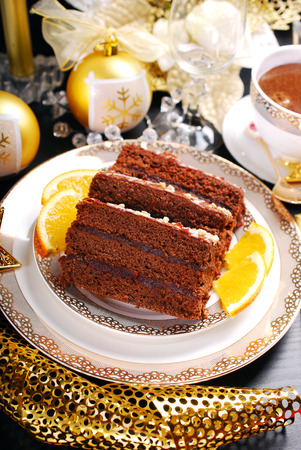 gingerbread cake: homemade gingerbread cake with plum confiture and chocolate glaze for Christmas dessert