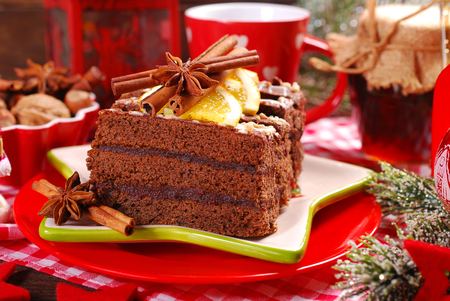 homemade gingerbread cake with plum confiture and chocolate glaze for christmas dessert