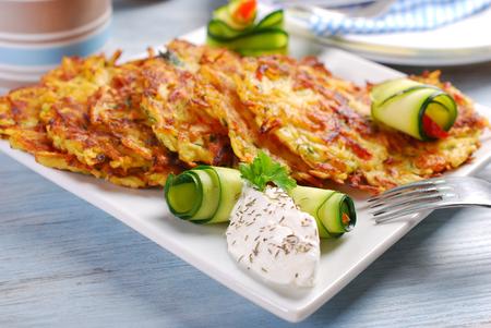 garnish: zucchini and potato pancakes served with herb cream cheese
