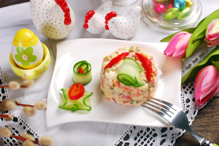 vegetable salad with potato,carrot,peas,pepper,egg,ham and mayonnaise for easter