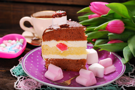 coffee jelly: delicious layered cake with heart shaped marshmallows,coffee and bunch of pink tulips for valentines day