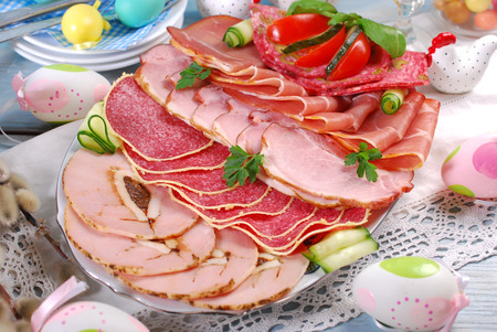 delicatessen: platter of cured ham and salami on eater table