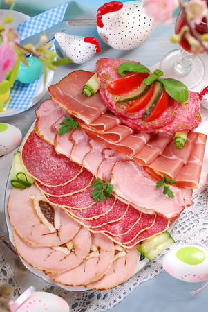 platter of cured ham and salami on eater table