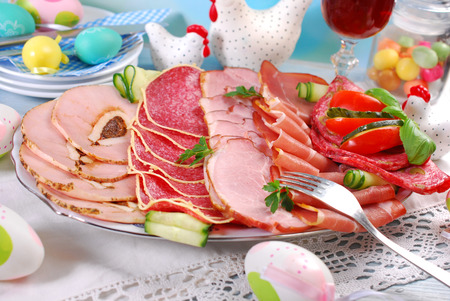 cured ham: platter of cured ham and salami on eater table