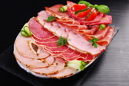 delicatessen: platter of sliced ham and cured meat