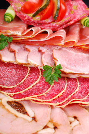 cold cuts: platter of sliced ham and cured meat