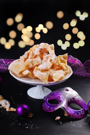 brushwood: traditional in Poland for carnival party deep-fried pastry -faworki- with icing sugar on black background