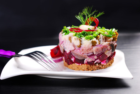 pumpernickel: herring tartar with beets, gherkin, horseradish and chive sauce on round pumpernickel bread for Easter