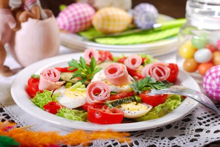 plate of ham salad with eggs and fresh vegetables for easter breakfast