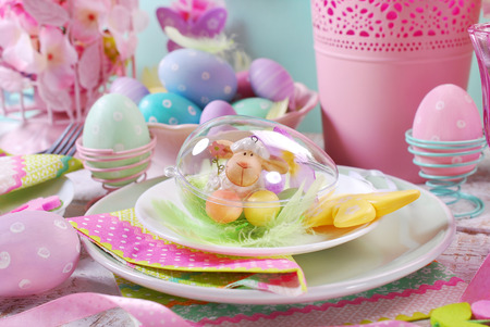 table decoration: beautiful easter table decoration with painted eggs and spring flowers in pastel colors