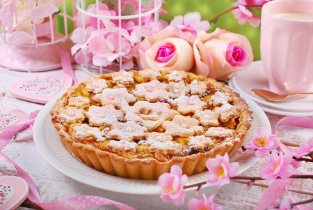 icing sugar: homemade apple pie with cut out flowers and icing sugar
