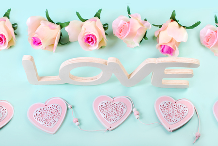 romantic love: romantic love background in pastel colors with word love,hearts and roses