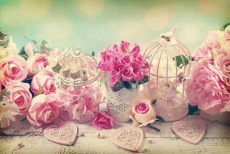 romantic vintage love background with bunches of roses, old cages and hearts Stok Fotoğraf - 57802139