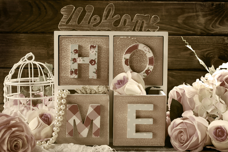 life style: welcome home still life with wooden vintage style decoration in sepia
