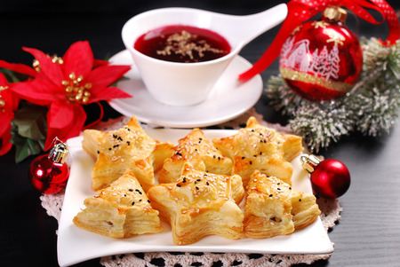 christmas eve red borscht and puff pastries stuffed with mushrooms