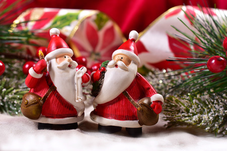 christmas decoration with two funny santa clauses figurine Stock Photo