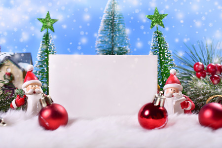 beautiful christmas greeting card with santa clauses figurine in winter scene and space for own text