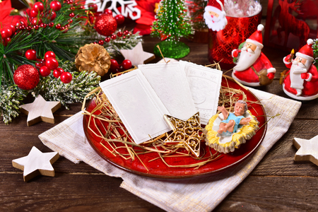 traditional christmas eve wafers on plate with hay
