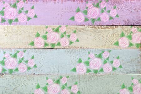 chabby: pastel color wooden background with painted floral pattern