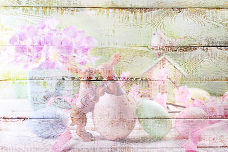 chabby: white wooden background with painted colorful easter pattern Stock Photo