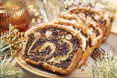 sliced poppy seed cake with nuts and raisins for christmas