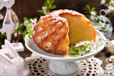 delicious ring cake in the shape of a flower on rustic table
