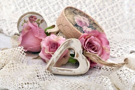 vintage style love decoration with wooden heart,roses,old laces and decoupage decorated box