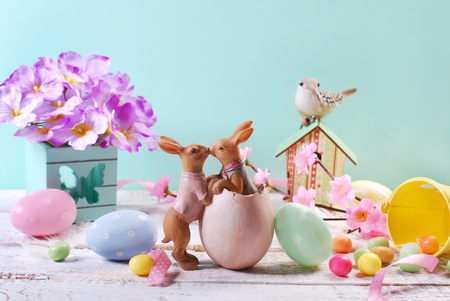 beautiful easter decoration with eggs,kissing rabbits and flowers in pastel colors