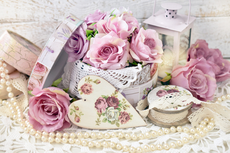romantic love decoration with hearts,roses and lanterns in shabby chic style for wedding or valentine`s day 写真素材