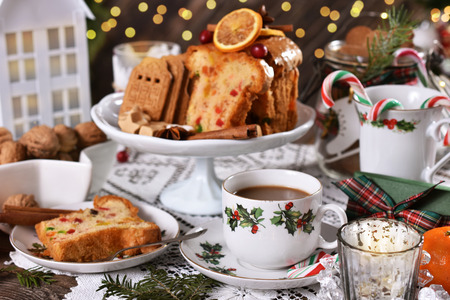 beautifully decorated christmas table with dried fruit cake,sweets and coffee