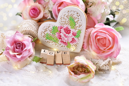 romantic decoration with pink roses,heart and LOVE letter stamps for Valentine or wedding day Reklamní fotografie