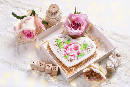 romantic stylle flat lay with a heart shaped cookie, lace and roses Reklamní fotografie