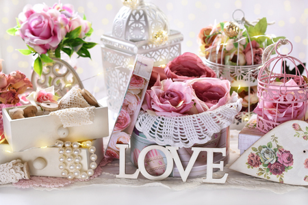 romantic decoration in vintage style with pink roses in the box,small drawers and  bird cages for Valentine or wedding day