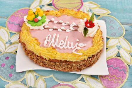 traditional polish easter cake called mazurek in egg shape on festive table -top view