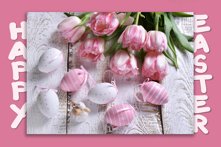 easter card with greeting text, painted eggs, lamb figurine and pink tulips on pink background Stockfoto - 120551477