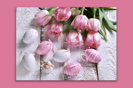 easter card with painted eggs, lamb figurine and fresh tulips on pink background Stockfoto - 120551478
