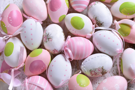 easter background with colorful eggs in pastel colors