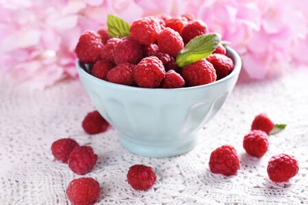 fresh raspberries in a mint bowl on the table