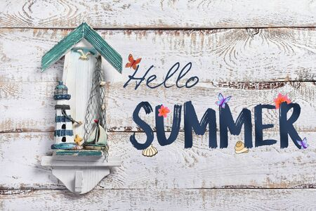 white wooden background with marine decor and text Hello summer
