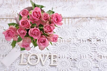 love background with a bunch of beautiful fresh pink roses
