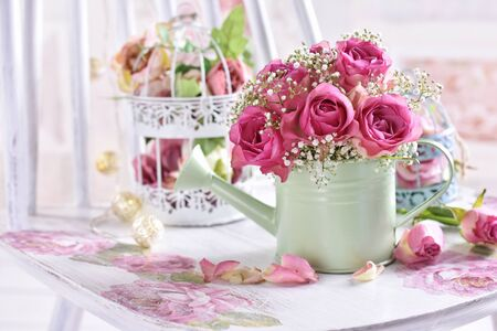 romantic style still life with bunch of pink roses and decors in pastel colors